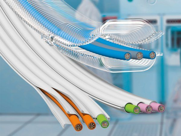 Løsningerne e-skin flat og e-skin soft er to pladsbesparende energiforsyningssystemer til renrum. De modulære energikæder er støjsvage i drift og nemme at fylde. I et andet udvidelsestrin for e-skin flat kan de enkelte kamre åbnes takket være lynlåssystemet. (Illustration: Igus GmbH)